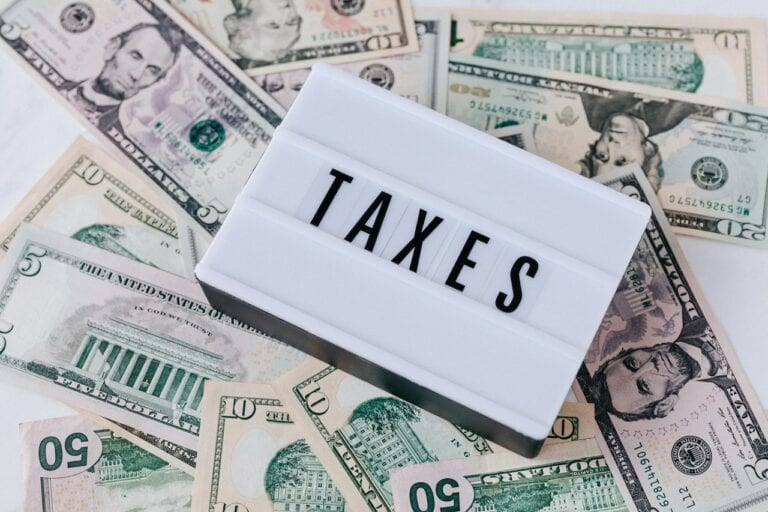 Photo Of Money And Taxes Sign Tax Tips For Selling Your House