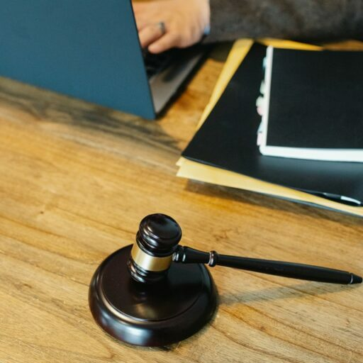 Gavel Judge Laptop , Knowing The Laws Is Important If You Are Wondering How To Be A Landlord