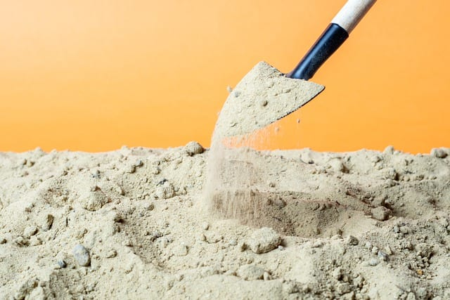 Shovel Scooping Sand For How To Build A Flood Wall